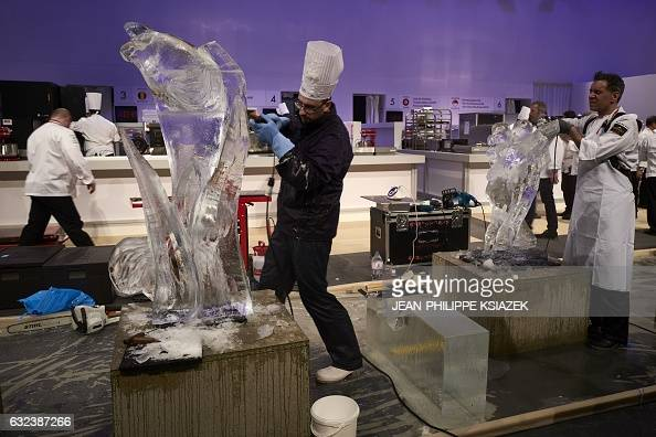 Pastry's chefs sculpt ice during the Pastries World Cup final on January 22 2017 in Chassieu outside Lyon as part of the Catering and Food...