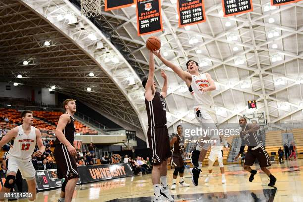 Pat Andree of the Lehigh Mountain Hawks defends against Sebastian Much of the Princeton Tigers during the first half at L Stockwell Jadwin Gymnasium...
