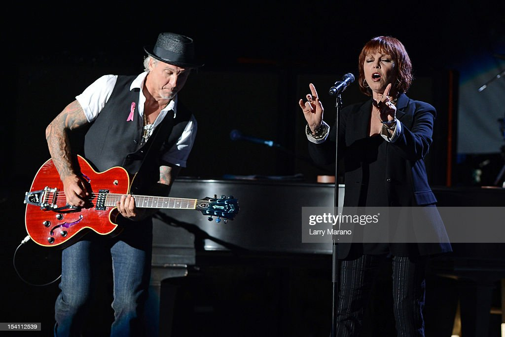 Pat Benatar and Neil Giraldo perform at Cruzan Amphitheatre on October 13, 2012 in West Palm Beach, Florida.