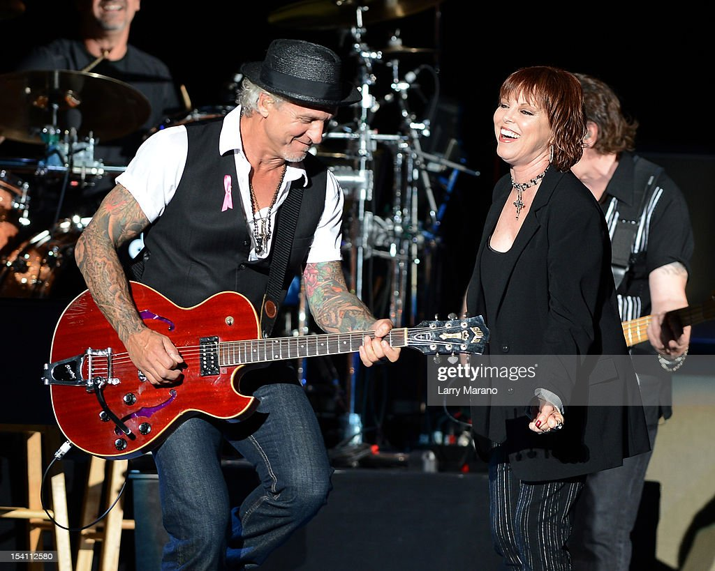 <a gi-track='captionPersonalityLinkClicked' href=/galleries/search?phrase=Pat+Benatar&family=editorial&specificpeople=171763 ng-click='$event.stopPropagation()'>Pat Benatar</a> and <a gi-track='captionPersonalityLinkClicked' href=/galleries/search?phrase=Neil+Giraldo&family=editorial&specificpeople=3269538 ng-click='$event.stopPropagation()'>Neil Giraldo</a> perform at Cruzan Amphitheatre on October 13, 2012 in West Palm Beach, Florida.
