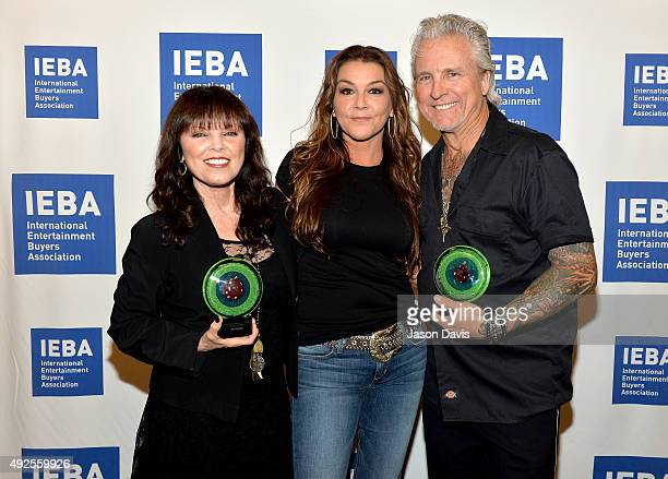 Pat Benatar Gretchen Wilson and Neil Giraldo pose backstage at the IEBA Honors Awards Ceremony during the IEBA 2015 Conference Day 3 on October 13...