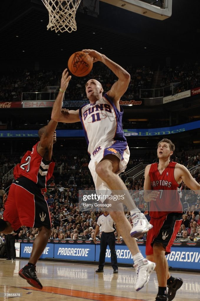 Pat Burke of the Phoenix Suns is fouled by Fred Jones of the Toronto Raptors on December 19 2006 at US Airways Center in Phoenix Arizona NOTE TO USER...
