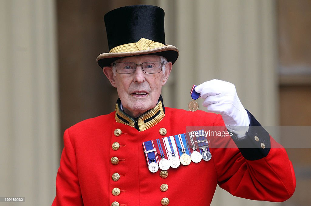 Pat Carroll poses with a medal he received for 60 years service outside Buckingham Palace on May 21, 2013 in London, England.
