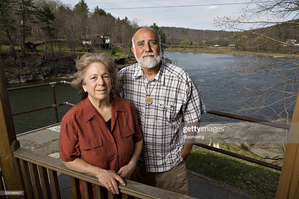 Pat Carullo, co-founder of Damascus Citizens for Sustainability, right, and Barbara Arrindell, director of the group, stand for a portrait on the banks of the Delaware River in Narrowsburg, New York, U.S., on Wednesday, April 7, 2010. Companies are spending billions to dislodge natural gas from a band of shale-sedimentary rock called the Marcellus shale that underlies Pennsylvania, West Virginia and New York. The band of rock, so designated because it pokes through near a city of that name in northern New York, may contain 262 trillion cubic feet of recoverable gas, the U.S. Department of Energy estimates. Photographer: Daniel Acker/Bloomberg via Getty Images