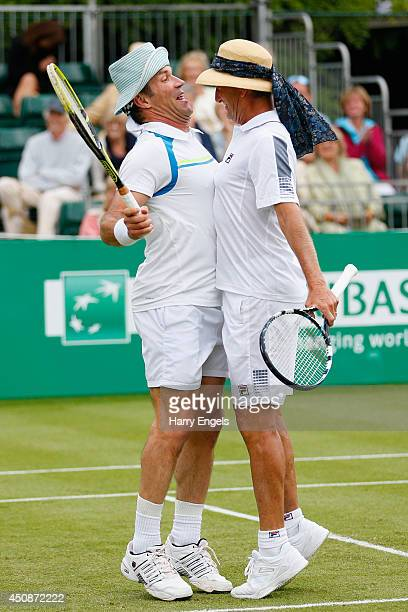 Pat Cash and Peter McNamara celebrate winning a point during their Men's Doubles exhibition match against Mansour Bahrami and Andrew Castle at the...