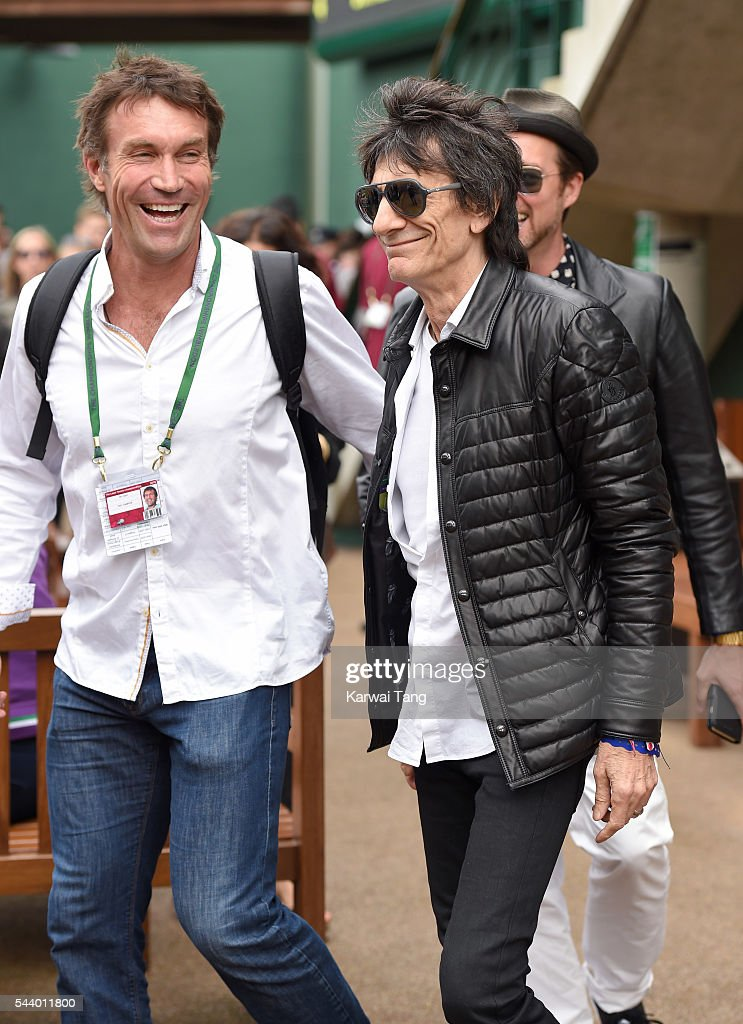 <a gi-track='captionPersonalityLinkClicked' href=/galleries/search?phrase=Pat+Cash&family=editorial&specificpeople=208695 ng-click='$event.stopPropagation()'>Pat Cash</a> and Ronnie Wood attend day four of the Wimbledon Tennis Championships at Wimbledon on June 30, 2016 in London, England.