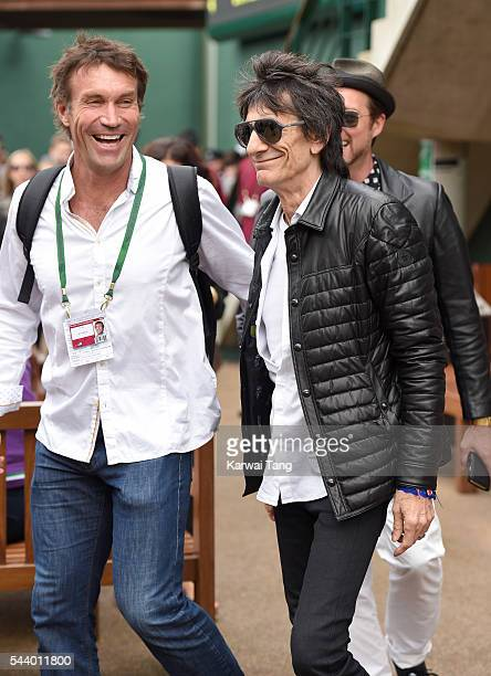 Pat Cash and Ronnie Wood attend day four of the Wimbledon Tennis Championships at Wimbledon on June 30 2016 in London England