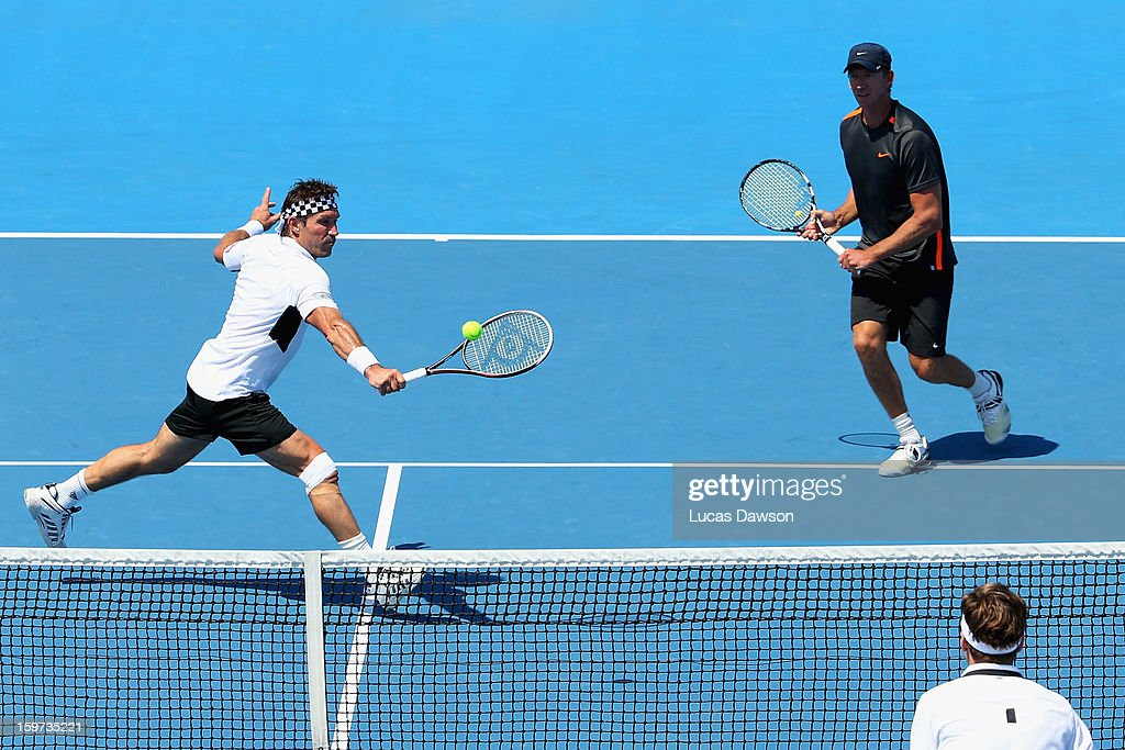 Pat Cash and Wayne Arthurs of Australia play a shot in their first round legends match against Thomas Enqvist of Sweden Fabrice Santoro of France during day seven of the 2013 Australian Open at Melbourne Park on January 20, 2013 in Melbourne, Australia.