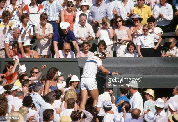 Pat Cash of Australia climbs into the stands to greet his father after his victory in the men's singles final at Wimbledon on 5th July 1987 Cash beat...