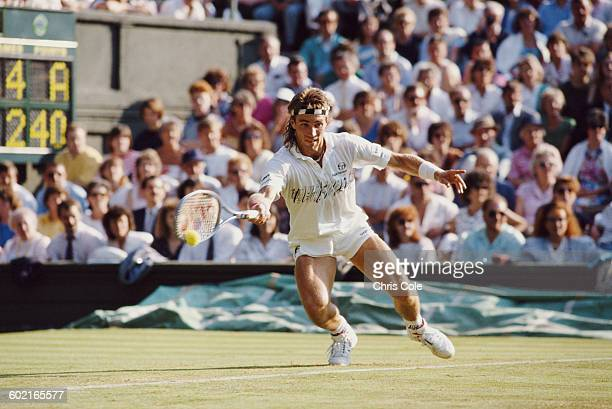 Pat Cash of Australia makes a return against Boris Becker during their Quarter Final match of the Men's Singles at the Wimbledon Lawn Tennis...
