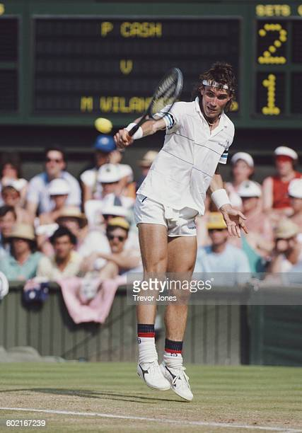 Pat Cash of Australia makes a return against Mats Wilander during their fourth round match of the Men's Singles at the Wimbledon Lawn Tennis...