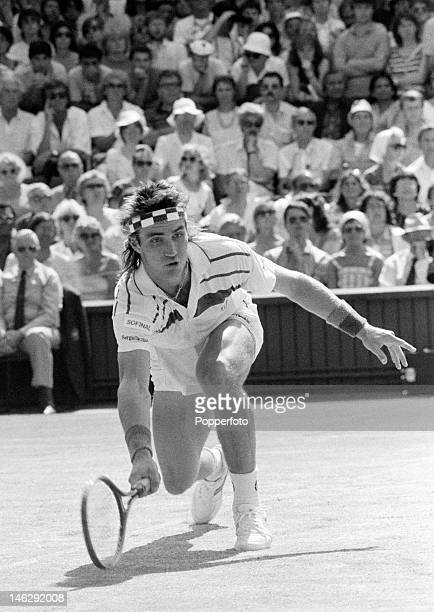 Pat Cash of Australia reaches to make a return against Ivan Lendl of Czechoslovakia during their Men's Singles Final match at the Wimbledon Lawn...