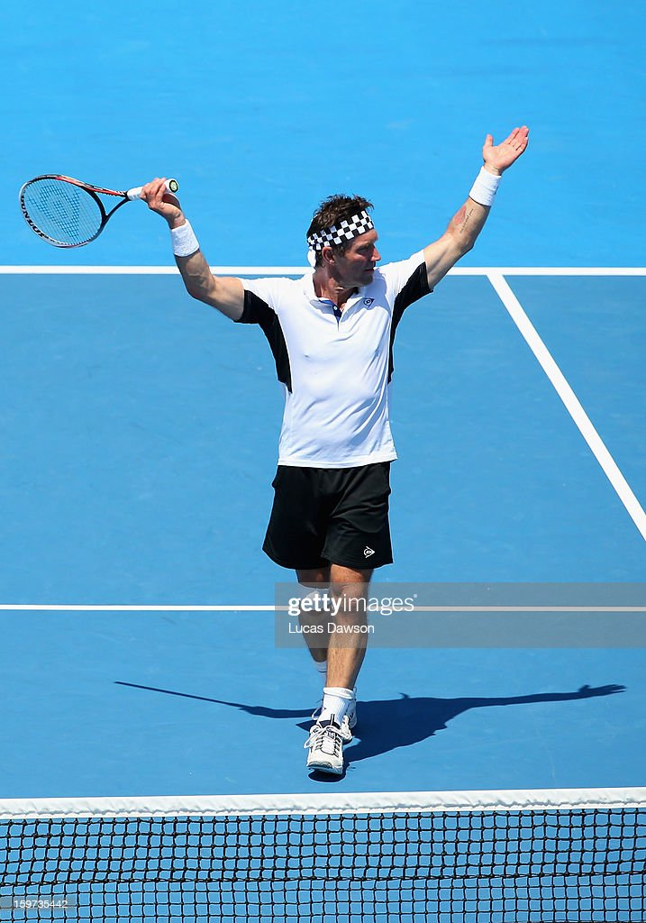 Pat Cash of Australia reacts in his first round legends match with Wayne Arthurs of Australia against Thomas Enqvist of Sweden Fabrice Santoro of France during day seven of the 2013 Australian Open at Melbourne Park on January 20, 2013 in Melbourne, Australia.