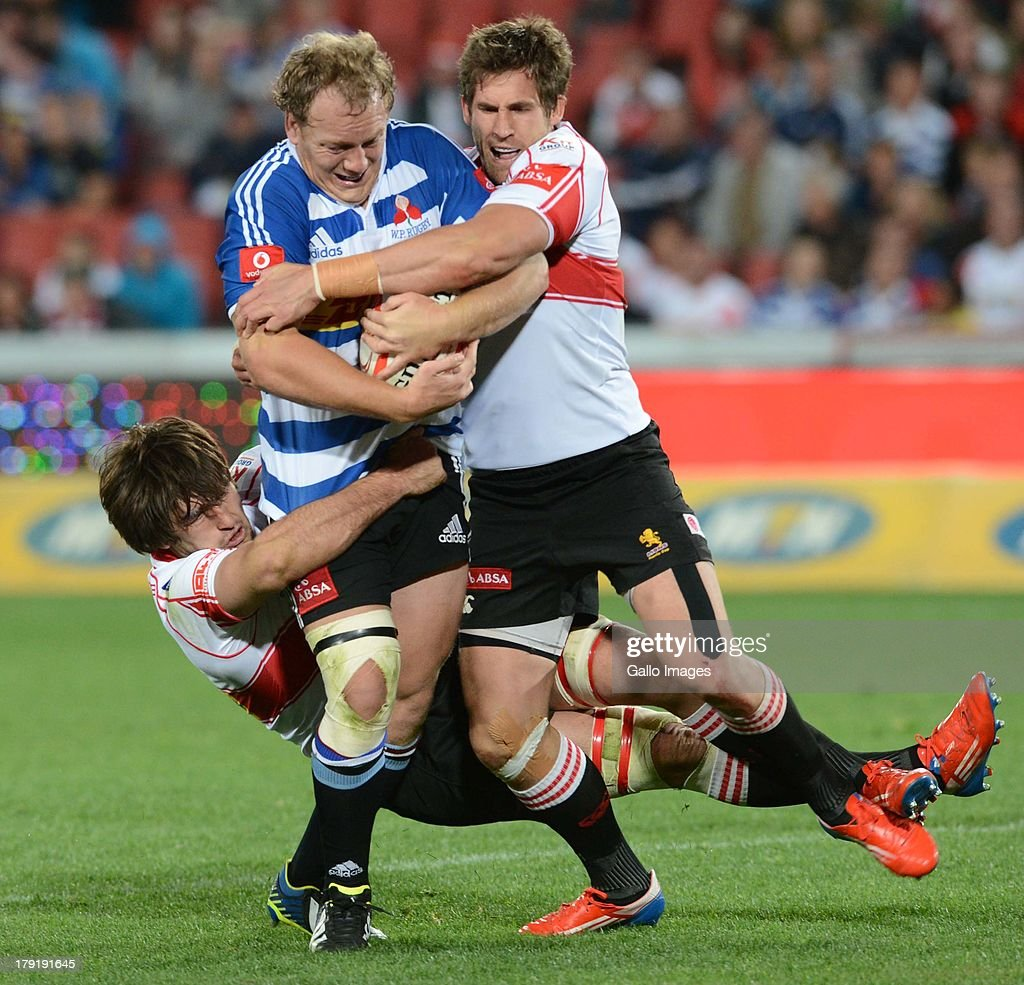 Pat Cilliers of the WP tackled during the Absa Currie Cup match between MTN Golden Lions and DHL Western Province at Ellis Park on August 30 2013 in...