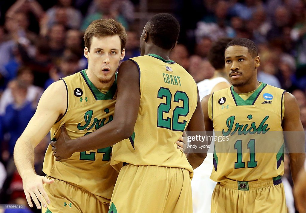 <a gi-track='captionPersonalityLinkClicked' href=/galleries/search?phrase=Pat+Connaughton&family=editorial&specificpeople=8664629 ng-click='$event.stopPropagation()'>Pat Connaughton</a> #24, <a gi-track='captionPersonalityLinkClicked' href=/galleries/search?phrase=Jerian+Grant&family=editorial&specificpeople=6681559 ng-click='$event.stopPropagation()'>Jerian Grant</a> #22 and Demetrius Jackson #11 of the Notre Dame Fighting Irish react after a play in the second half against the Kentucky Wildcats during the Midwest Regional Final of the 2015 NCAA Men's Basketball tournament at Quicken Loans Arena on March 28, 2015 in Cleveland, Ohio.