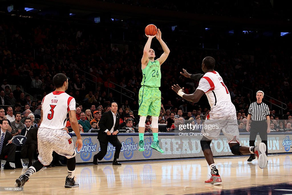 Pat Connaughton #24 of the Notre Dame Fighting Irish attempts a shot against the Louisville Cardinals during the semifinals of the Big East Men's Basketball Tournament at Madison Square Garden on March 15, 2013 in New York City.