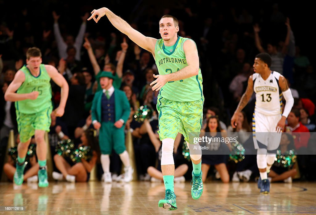 Pat Connaughton #24 of the Notre Dame Fighting Irish celebrates after he made a 3-point shot in the second half against the Marquette Golden Eagles during the quaterfinals of the Big East Men's Basketball Tournament at Madison Square Garden on March 14, 2013 in New York City.