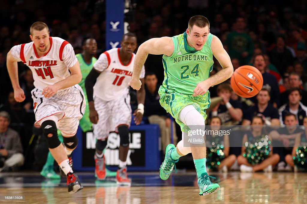 Pat Connaughton #24 of the Notre Dame Fighting Irish chases down a looseball against the Louisville Cardinals during the semifinals of the Big East Men's Basketball Tournament at Madison Square Garden on March 15, 2013 in New York City.