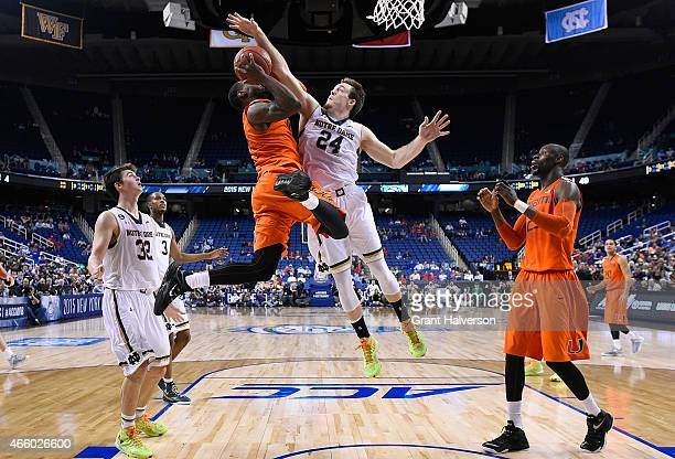 Pat Connaughton of the Notre Dame Fighting Irish defends a drive by Sheldon McClellan of the Miami Hurricanes during the quarterfinals of the ACC...