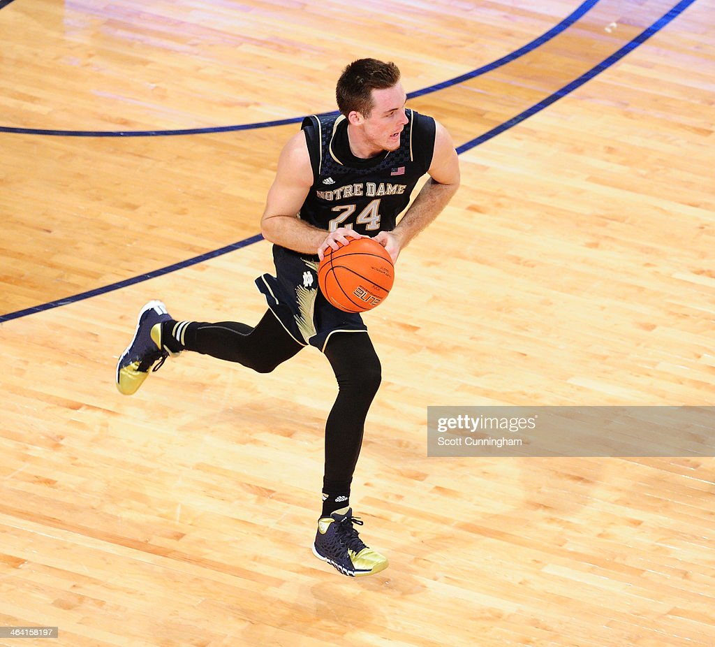 <a gi-track='captionPersonalityLinkClicked' href=/galleries/search?phrase=Pat+Connaughton&family=editorial&specificpeople=8664629 ng-click='$event.stopPropagation()'>Pat Connaughton</a> #24 of the Notre Dame Fighting Irish drives against the Georgia Tech Yellow Jackets at McCamish Pavilion on January 11, 2014 in Atlanta, Georgia. Photo by Scott Cunningham/Getty Images)