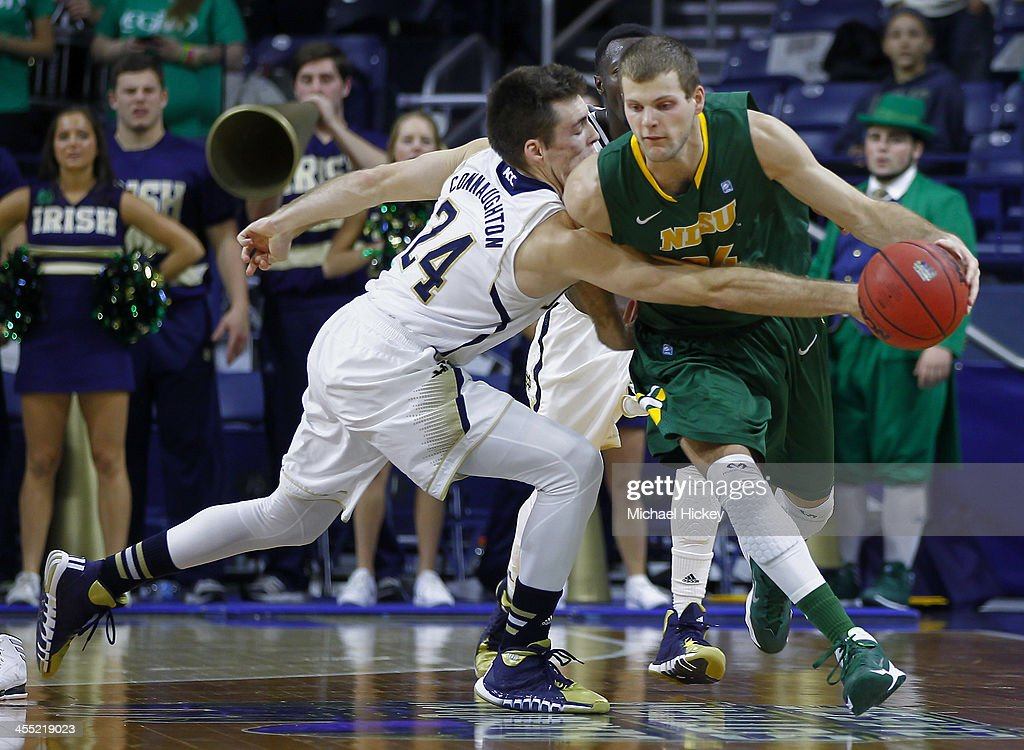Pat Connaughton #24 of the Notre Dame Fighting Irish reaches for the ball as Taylor Braun #24 of the North Dakota State Bison tries to maintain control at Purcel Pavilion on December 11, 2013 in South Bend, Indiana. North Dakota State defeated Notre Dame 73-69.