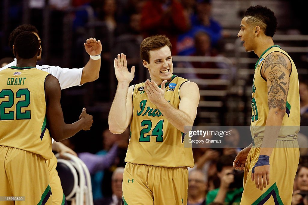 <a gi-track='captionPersonalityLinkClicked' href=/galleries/search?phrase=Pat+Connaughton&family=editorial&specificpeople=8664629 ng-click='$event.stopPropagation()'>Pat Connaughton</a> #24 of the Notre Dame Fighting Irish reacts with teammates after a play in the second half against the Kentucky Wildcats during the Midwest Regional Final of the 2015 NCAA Men's Basketball tournament at Quicken Loans Arena on March 28, 2015 in Cleveland, Ohio.