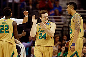 Pat Connaughton of the Notre Dame Fighting Irish reacts with teammates after a play in the second half against the Kentucky Wildcats during the...