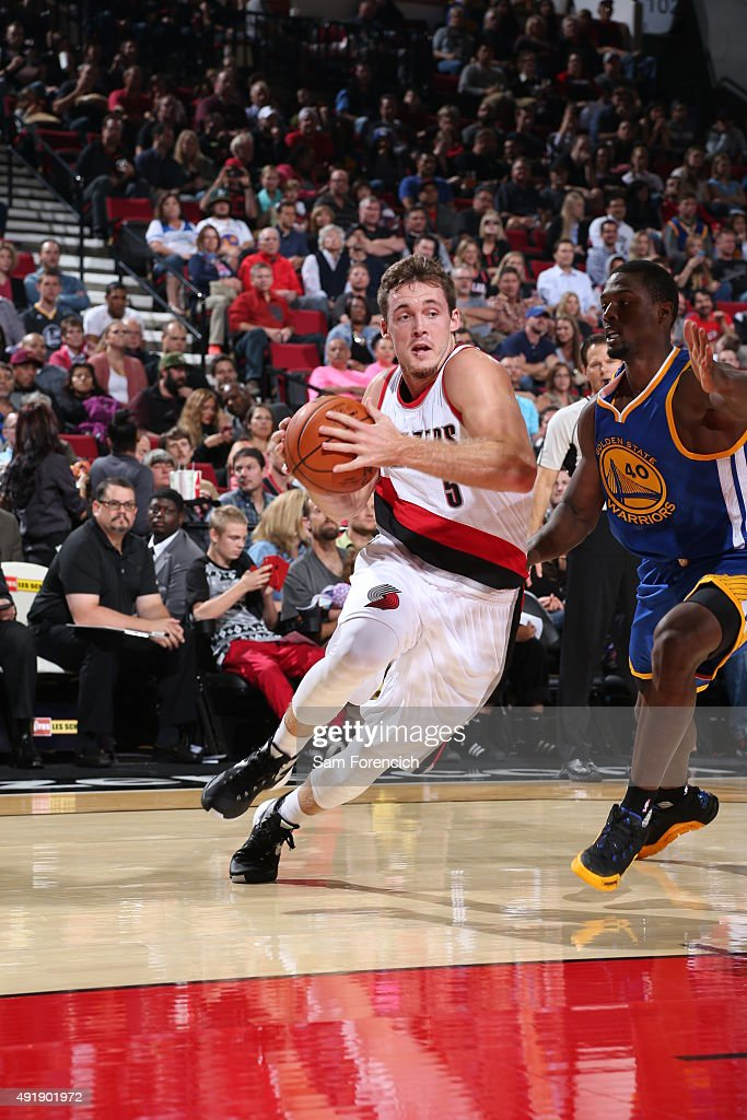 <a gi-track='captionPersonalityLinkClicked' href=/galleries/search?phrase=Pat+Connaughton&family=editorial&specificpeople=8664629 ng-click='$event.stopPropagation()'>Pat Connaughton</a> #5 of the Portland Trail Blazers drives to the basket against the Golden State Warriors during a preseason game on October 8, 2015 at the Moda Center in Portland, Oregon.