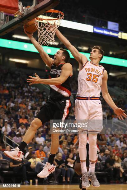 Pat Connaughton of the Portland Trail Blazers lays up a shot past Dragan Bender of the Phoenix Suns during the second half of the NBA game at Talking...