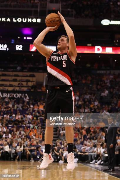 Pat Connaughton of the Portland Trail Blazers puts a three point shot against the Phoenix Suns during the second half of the NBA game at Talking...