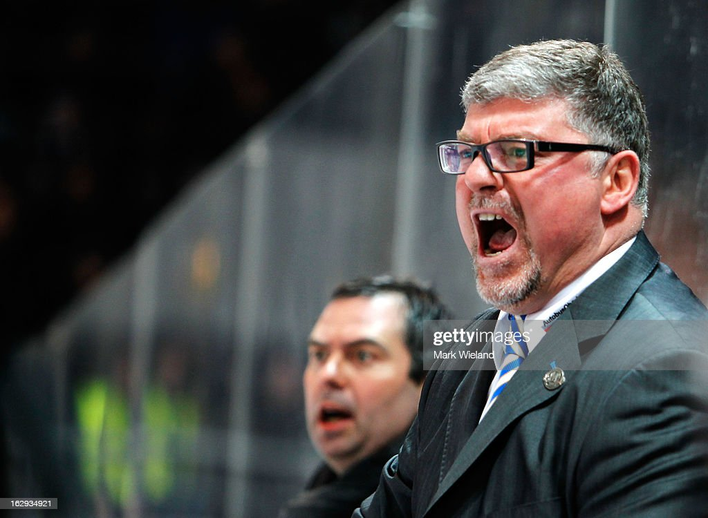 Pat Cortina, head coach of EHC Red Bull Muenchen shouts at the referee during the DEL match between EHC Red Bull Muenchen and Thomas Sabo Ice Tigers at Olympia Eishalle on March 1, 2013 in Munich, Germany.