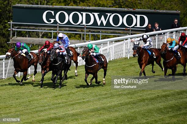 Pat Cosgrave riding Fiftyshadesofgrey win The winnerseventscom Stakes at Goodwood racecourse on May 21 2015 in Chichester England