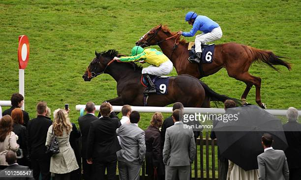 Pat Cosgrave riding Libranno beats Ahmed Ajtebi riding Ecliptic to the finish line during the EBF Joe Aggio 30th Birthday Maiden Stakes at The...