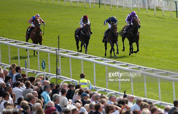Pat Cosgrave riding Storm The Stars win The Betway Great Voltigeur Stakes from Bondi Beach at York racecourse on August 19 2015 in York England