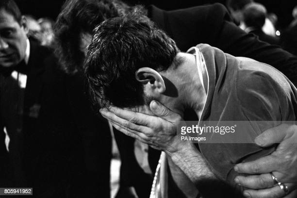 Pat Cowdell is led away sobbing after he was knocked out in the 1st round of his featherweight match with Azumah Nelson who was defending his WBC...