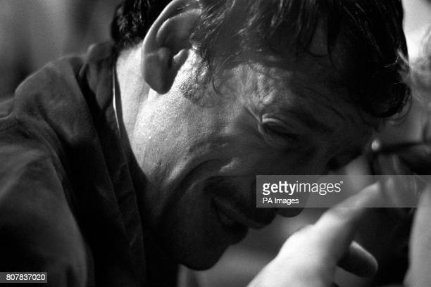Pat Cowdell sobs after he was knocked out in the 1st round of his featherweight match with Azumah Nelson who was defending his WBC featherweight title