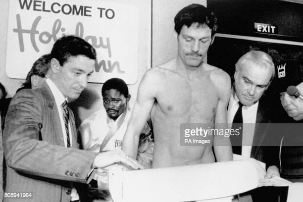 Pat Cowdell weighs in at the Holiday Inn in Birmingham watched by Azumah Nelson who defends his WBC Featherweight title when he meets Cowdell at the...