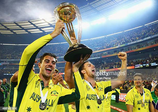 Pat Cummins and Mitch Marsh of Australia celebrate during the 2015 ICC Cricket World Cup final match between Australia and New Zealand at Melbourne...