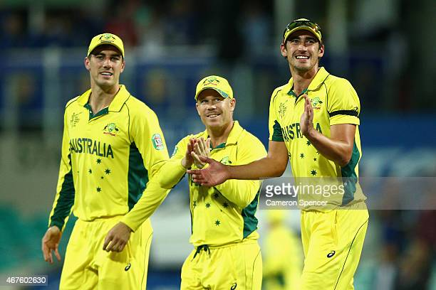 Pat Cummins David Warner and Mitchell Starc of Australia thank the crowd after winning the 2015 Cricket World Cup Semi Final match between Australia...