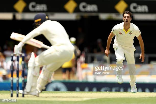 Pat Cummins of Australia bowls a short ball to Mark Stoneman of England during day one of the First Test Match of the 2017/18 Ashes Series between...