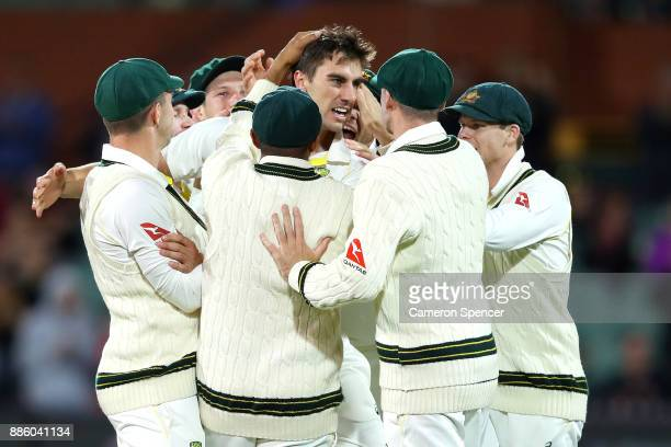 Pat Cummins of Australia celebrates after taking the wicket of Dawid Malan of England during day four of the Second Test match during the 2017/18...