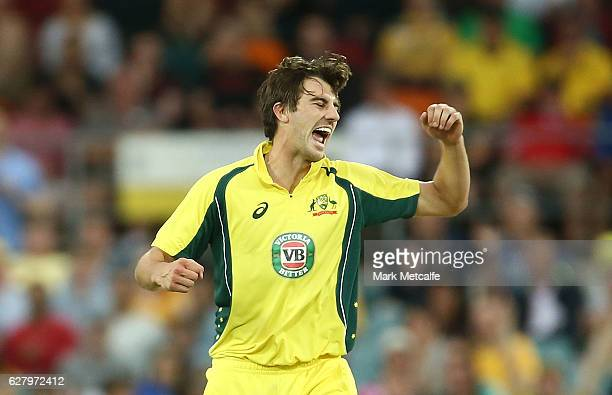 Pat Cummins of Australia celebrates after taking the wicket of Martin Guptill of New Zealand during game two of the One Day International series...