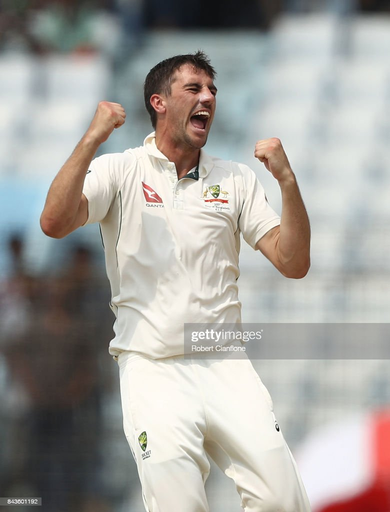 Pat Cummins of Australia celebrates after taking the wicket of Mushfiqur Rahim of Bangladesh during day four of the Second Test match between Bangladesh and Australia at Zahur Ahmed Chowdhury Stadium on September 7, 2017 in Chittagong, Bangladesh.
