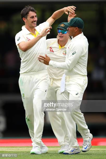 Pat Cummins of Australia celebrates dismissing Jonny Bairstow of England during day two of the First Test Match of the 2017/18 Ashes Series between...