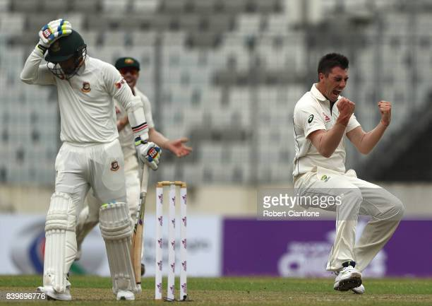 Pat Cummins of Australia celebrates taking the wicket of Shabbir Rahman Roman of Bangladesh during day one of the First Test match between Bangladesh...
