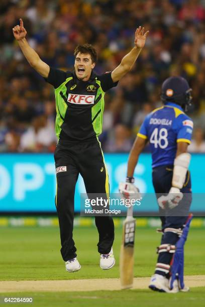 Pat Cummins of Australia celebrates the wicket of Uvula Tharanga of Sri Lanka walks out to bat during the first International Twenty20 match between...