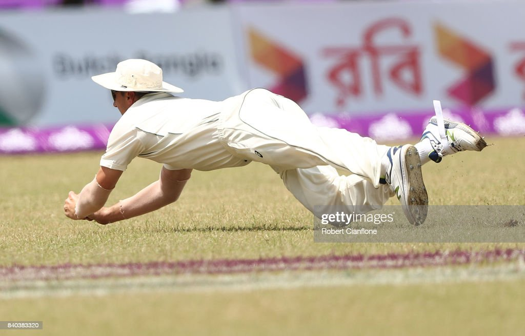 Pat Cummins of Australia takes a catch to dismiss Shakib Al Hasan of Bangladesh during day three of the First Test match between Bangladesh and Australia at Shere Bangla National Stadium on August 29, 2017 in Mirpur, Bangladesh.