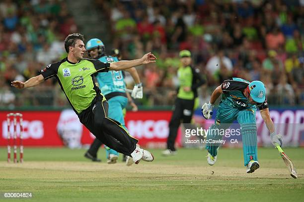 Pat Cummins of the Thunder attempts to run out Chris Lynn during the Big Bash League match between the Sydney Thunder and Brisbane Heat at Spotless...