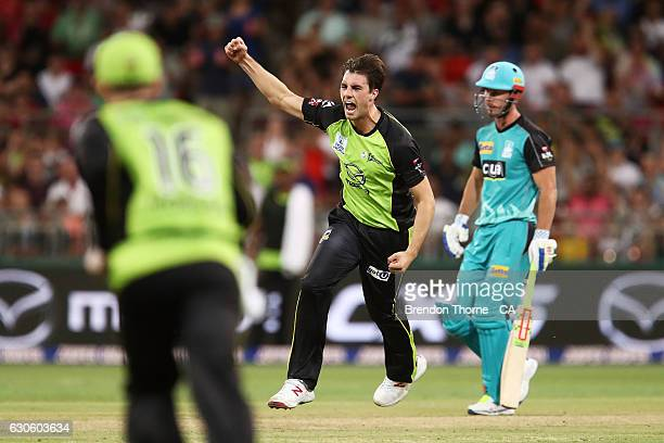 Pat Cummins of the Thunder celebrates after claiming the wicket of Brendon McCullum of the Heat during the Big Bash League match between the Sydney...