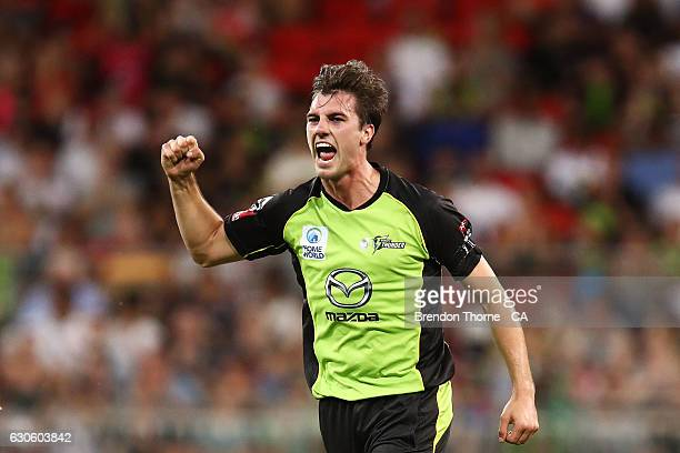 Pat Cummins of the Thunder celebrates after claiming the wicket of Alex Ross of the Heat during the Big Bash League match between the Sydney Thunder...